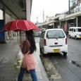 傘紅きうしろ美人や梅雨に入る